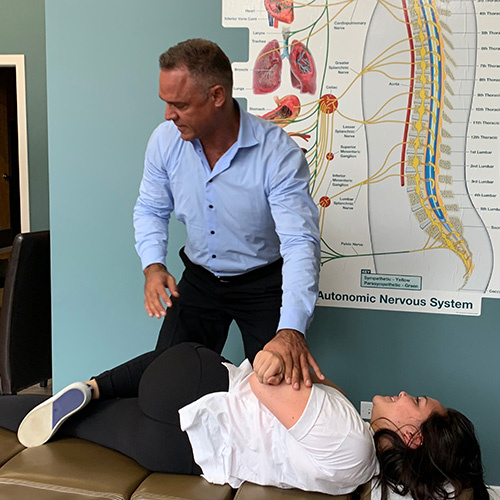 Dr. Jacobazzi doing a chiropractic adjustment